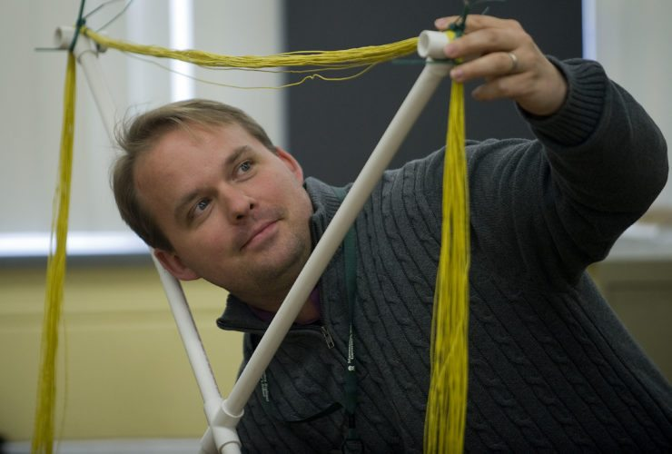 Russell Kohrs, a teacher at Massanutten Governors School in Mount Jackson, looks through this homemade loop antenna designed for use in solar observation. Kohrs and his students are working on a project with NASA's Jet Propulsion Laboratory. Rich Cooley/Daily